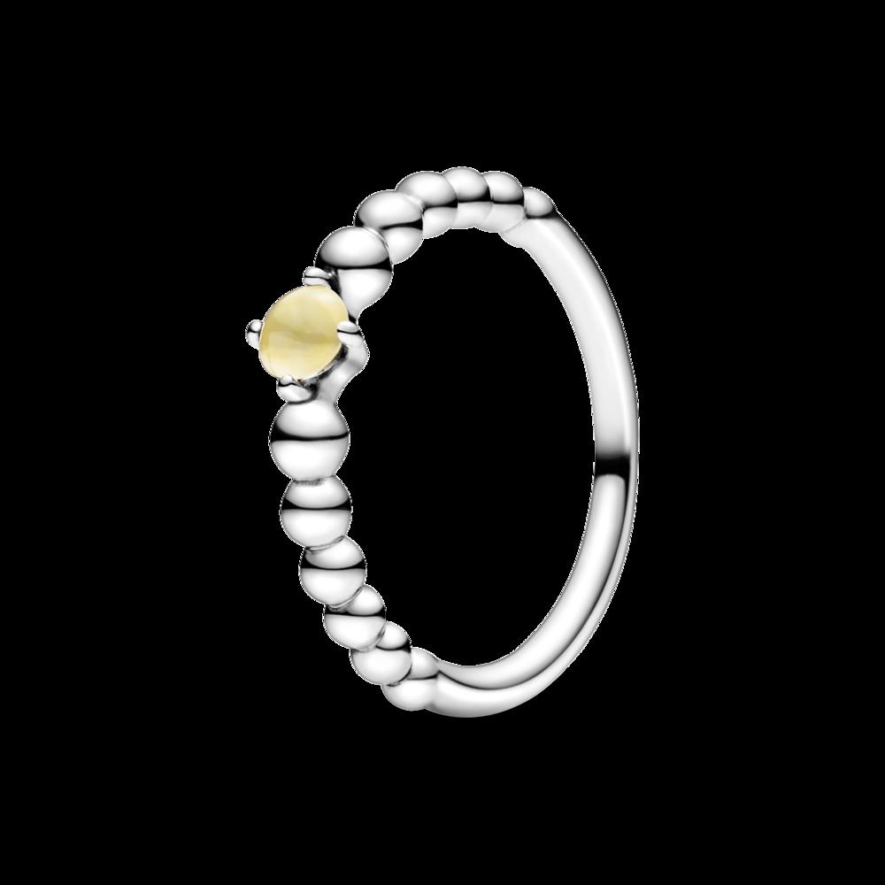 Каблучка з каменем медового кольору
