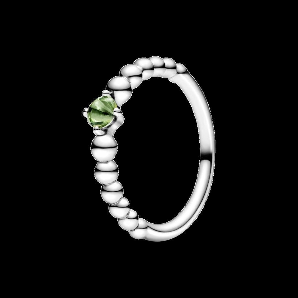 Каблучка з каменем весняно-зеленого кольору