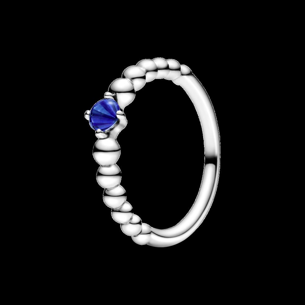 Каблучка з каменем синього кольору