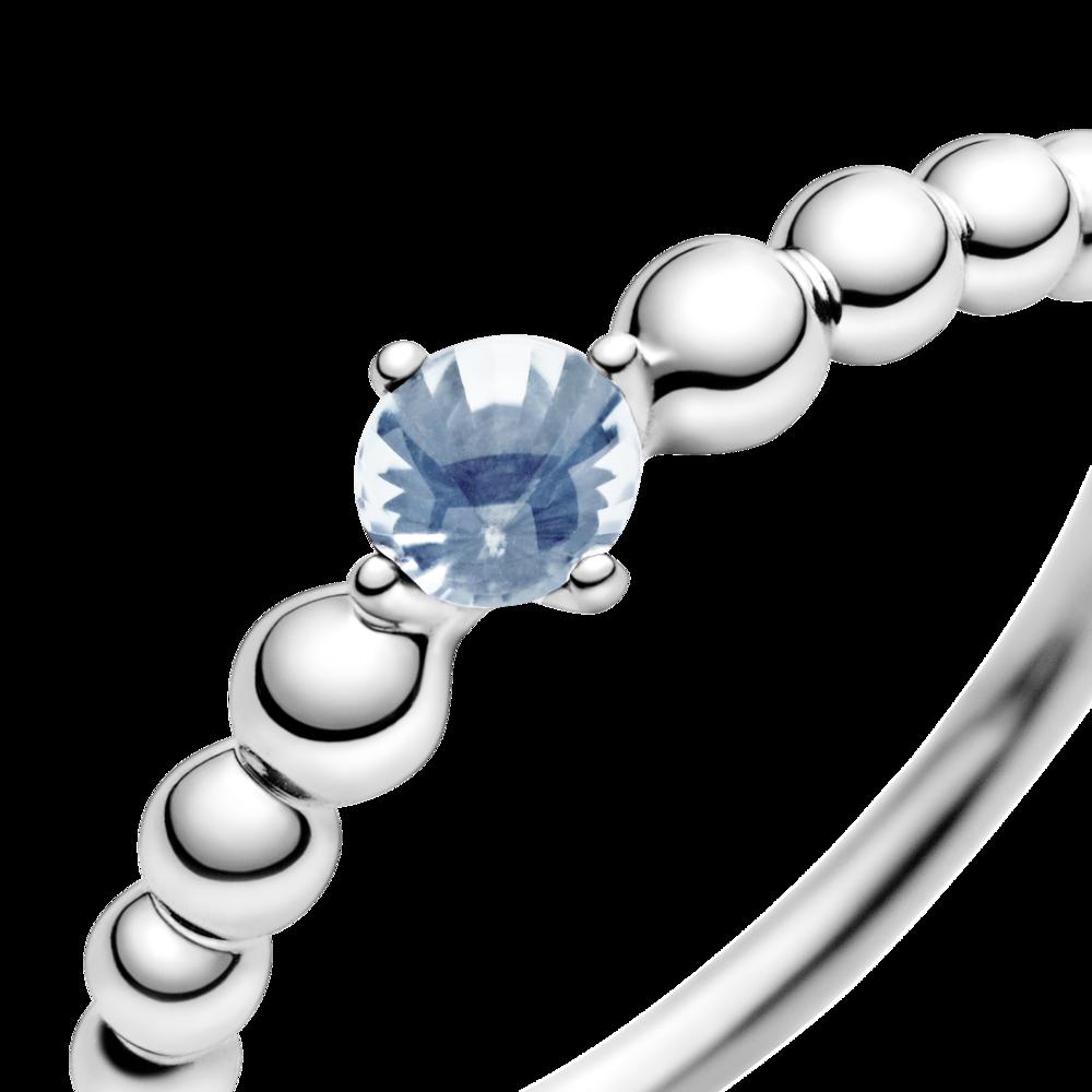Каблучка з блакитним каменем